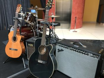 Fender Twin Reverb and Vox AC15 guitar amps; Takamine and Cordoba acoustic-electric guitars; Yamaha Absolute Hybrid Maple kit