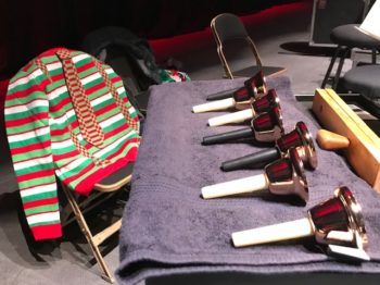 Brass handbells (and a snazzy holiday sweater just for kicks)! 1.5 octaves available.